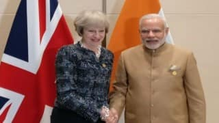 Prime Minister Narendra Modi meets UK's new PM Theresa May