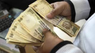 INR to USD forex rates: Rupee runs up more losses, down 8 paise against dollar