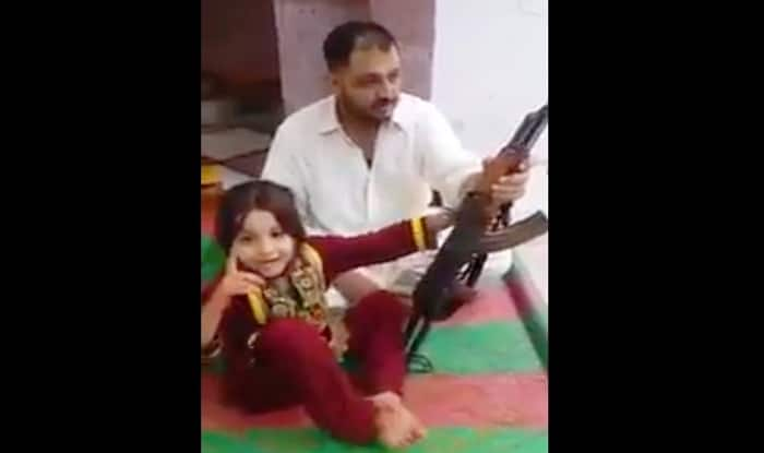 Pakistani father teaches little girl to fire AK 47 and make her threaten Narendra Modi: Watch Video