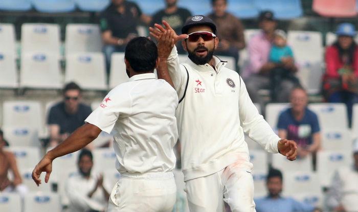 Virat Kohli & Mohammad Shami celebrate fall of a wicket on day 4 of Mohali Test | IANS Photo