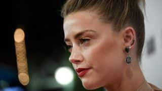 Amber Heard pays $350,000 to charity