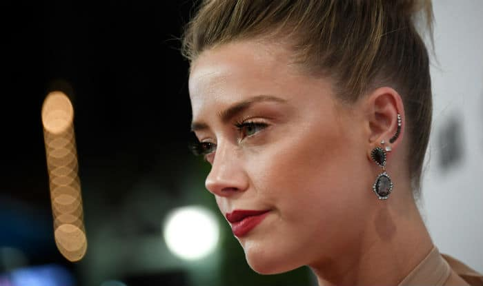 Amber Heard pays 0,000 to charity