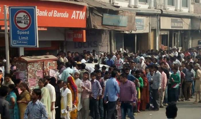 Queues at ATMs, banks grow shorter but wait for cash continues