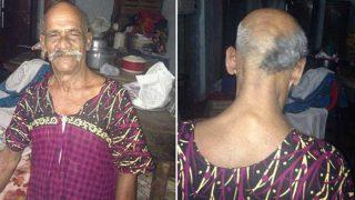 इस 70 साल के बुजुर्ग ने मुंडवाया आधा सिर, बोला- नरेंद्र मोदी की गद्दी जाने पर ही उगाएगा बाल