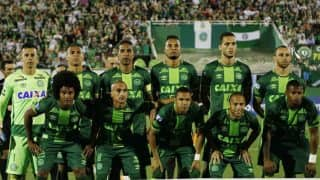Colombia plane crash: Fans cram into Brazil football stadium to mourn dead players