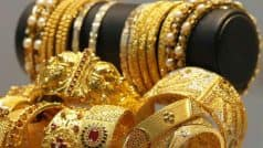 Gold futures decline 0.50 per cent on weak global cues
