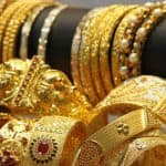 Gold slips by Rs 45 on subdued demand, silver rises