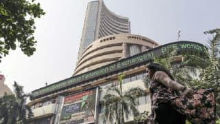Sensex, Nifty open in red; Rupee and Pound weaken against Dollar