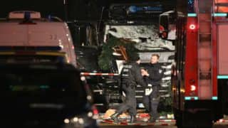 Germany hunts 'violent and armed' Tunisian in truck attack