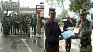 India, Pakistan security personnel exchange sweets at Wagah Border