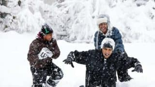 Barack Obama playing in the snow with daughters Sasha and Malia will make you nostalgic already!