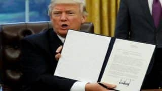 President Donald Trump signs order withdrawing from TPP