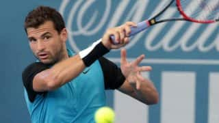 Australian Open 2017: Grigor Dimitrov advances to quarter finals by beating injury-hampered Denis Istomin
