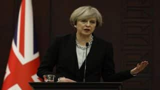 Theresa May repeatedly refuses to condemn Trump's immigration ban