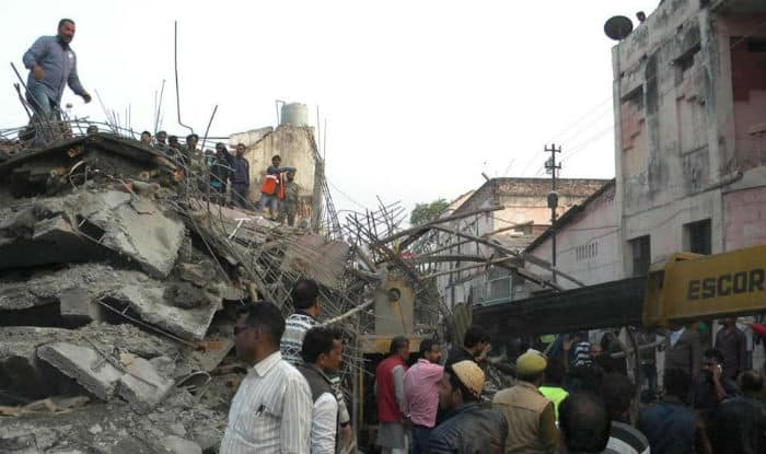 India building collapse kills at least five workers and traps 50 more