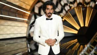 Dev Patel looked every bit the charming gentleman in a white tuxedo at the Academy Awards 2017