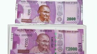WTF! Rs 2000 fake currency note of 'Children Bank of India' available at State of India ATM! Spot the difference
