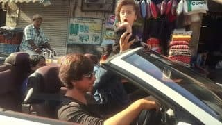 Video: Shah Rukh Khan and AbRam Khan spotted in open BMW convertible on Mumbai roads!