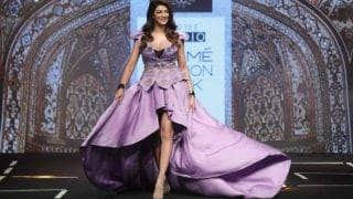 Bollywood glam goddess Suhsmita Sen looked stunning in majestic purple gown at Lakme Fashion Week 2017!