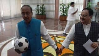 Promoting FIFA-U17 World Cup to be hosted by India, Sports Minister Vijay Goel attends BJP meet with a football