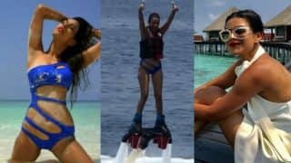 Nia Sharma posts new hot bikini pictures! Sexy TV actress' flyboarding video from Maldives vacation is a must see!