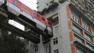 Train arrives to pick passengers from this building in China's Chongqing city! (Watch Video)