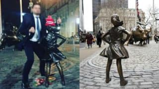 Man in suit humps on 'Fearless Girl' statue in Wall Street built for International Women's Day!