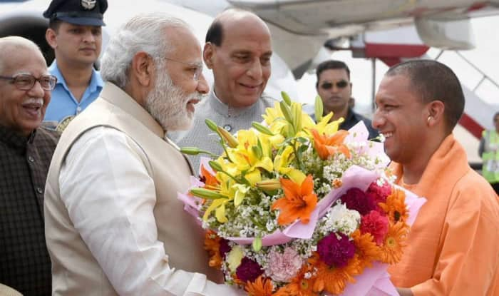 Uttar Pradesh Chief Minister Yogi Adityanath presenting bouquet to Prime Minister Narendra Modi during his visit to the state in the month of March.