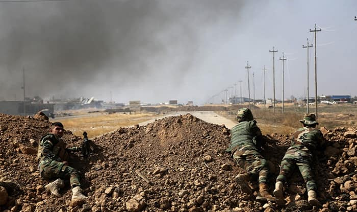 Mosul: 61 bodies pulled from rubble in Iraq as airstrikes probed