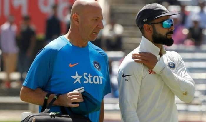 Virat Kohli going off the field with team physio Patrick Farhart after hurting his shoulder on Day 1 of Ranchi Test | BCCI Image