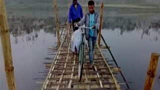 Assam: Man carries brother's body on bicycle due to absence of motorable road in Sarbanand Sonowal's constituency