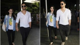 Pregnant Soha Ali Khan and hubby Kunal Khemu arrive from a babymoon (view HQ pics)