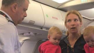 American Airlinesattendant hits female passenger with baby stroller! Staffer suspended (Watch video)