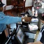 This cashier's calm reaction to being held at gunpoint is shocking (Watch Video)
