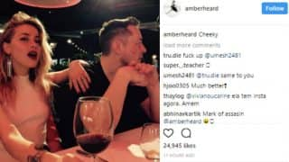 Amber Heard kisses Elon Musk on the cheek! Makes their relationship official on social media with this picture!