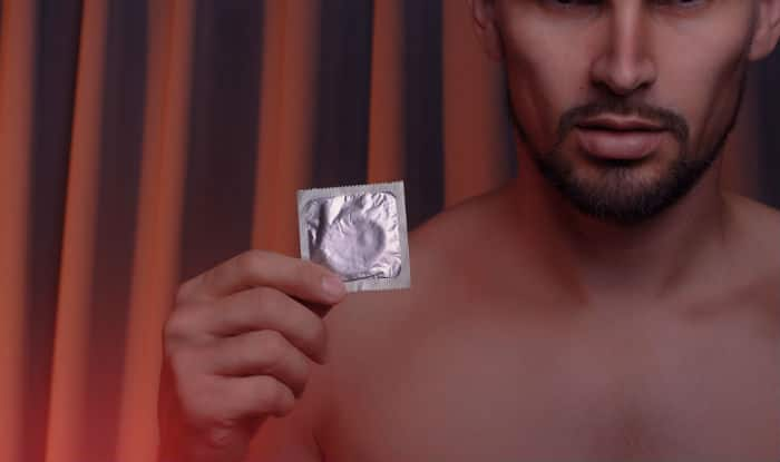 Putting a condom on a man