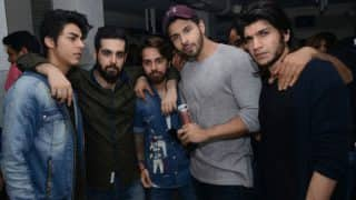 Shah Rukh Khan's son Aryan attends a club opening as a celebrity guest but has no time to smile!
