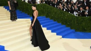 Adriana Lima's wardrobe malfunction at Met Gala 2017: Victoria's Secret model flashes underwear in a black slit gown