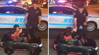 New York police pulls over two kids on Range Rover for driving on pavement (Watch cute Video)