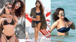 Priyanka Chopra in a sexy blue bikini proves she is a Baywatch girl! See hot pictures of Indian actress enjoying beach day