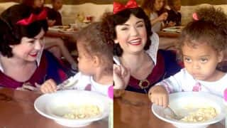 Little girl unimpressed by Snow White, concentrates on food instead (Watch Video)