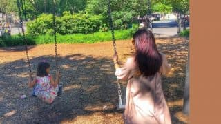 Abhishekh Bachchan's photo of Aishwarya, and Aaradhya, swinging together is just too awwdorable to miss!