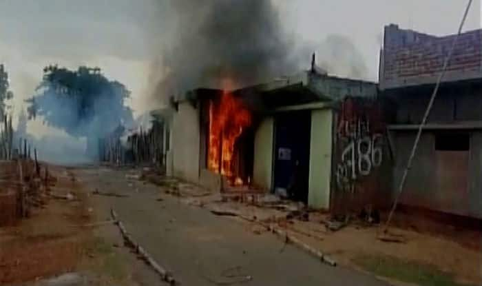 Jhajrkhand dead cow found outside the house, mob lynched old man and set on fire his house too