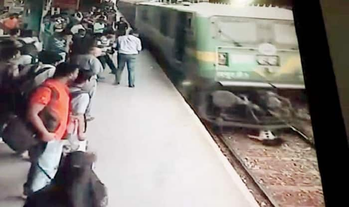 Caught on camera: Girl listening a song with earphones run over by Mumbai local; survives