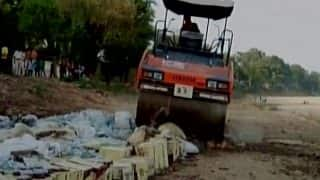 Bihar: Bottles, pouches containing 60,000 liters of liquor crushed in Rohtas