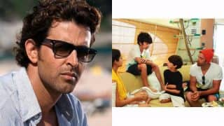 Hrithik Roshan gets curious as his kids discuss something! (View pic)