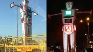 Indore has a 14-feet tall Traffic Police Robot directing traffic! Watch Video of India's first Robocop