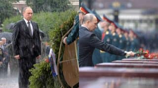 Vladimir Putin is drenched but continues to honour the death of Russians killed in the Second World War! See Picture of Russian President