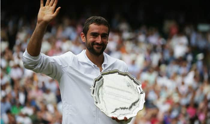 Runner-up Marin Cilic of Croatia poses with his trophy after the Men's Singles final against Roger Federer of Switzerland at the All England Lawn Tennis and Croquet Club at Wimbledon | Getty Images