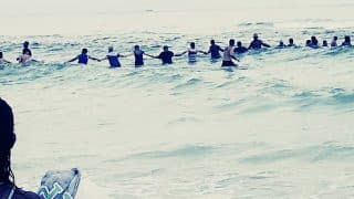 Florida Beachgoers form human chain to Save Family Trapped in Seawater (See Picture)